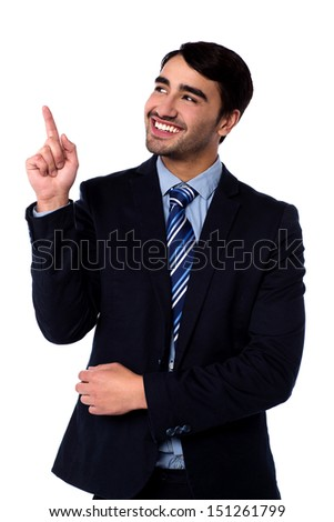 Smiling corporate guy pointing at something