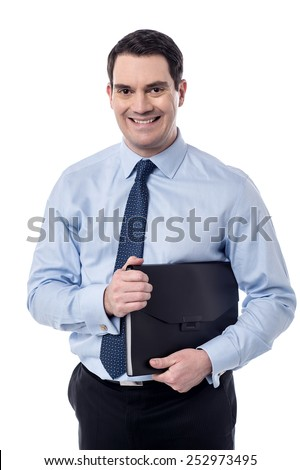 Smiling corporate man holding his folder files - stock photo