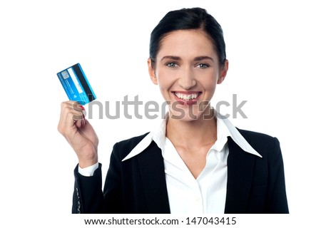 Smiling corporate woman holding up credit card