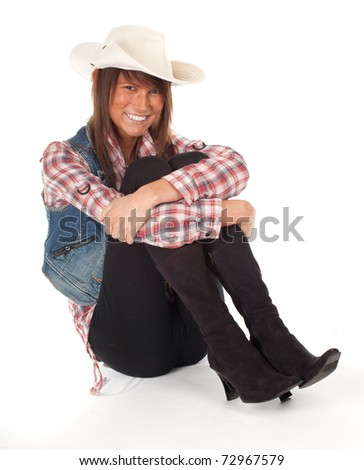 smiling country girl in chequered shirt with bright hat