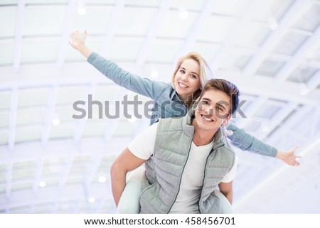 Smiling couple at the airport
