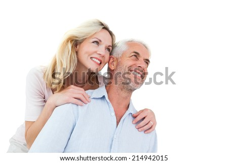 Smiling couple embracing and looking on white background - stock photo
