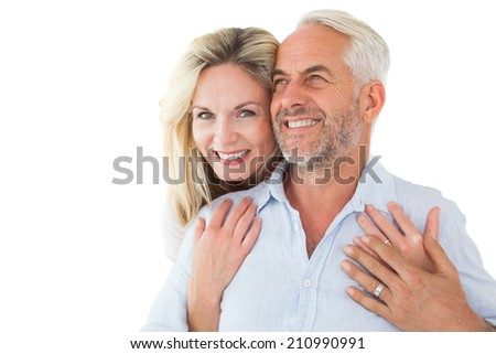 Smiling couple embracing with woman looking at camera on white background - stock photo