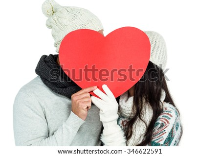 Smiling couple holding paper heart on white screen - stock photo