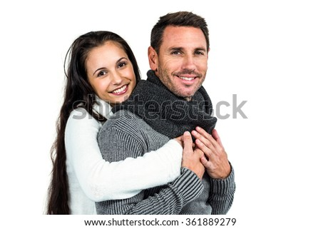 Smiling couple hugging and looking at camera on white screen - stock photo