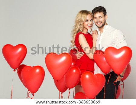 Smiling couple hugging at each other  - stock photo