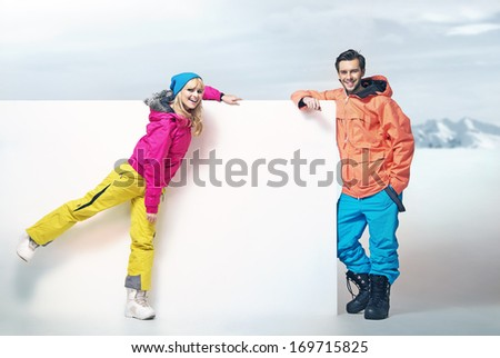 Smiling couple in mountain - stock photo
