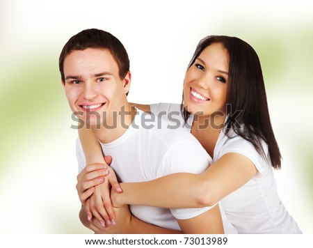 Smiling couple isolated on a green background