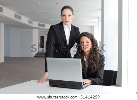 Smiling couple of  businesswomen - stock photo