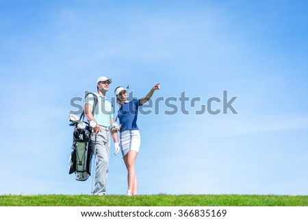 Smiling couple on the golf course