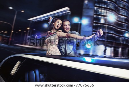 Smiling couple over night city background - stock photo