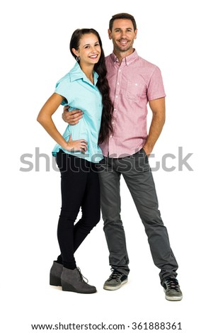 Smiling couple posing for camera against white background - stock photo