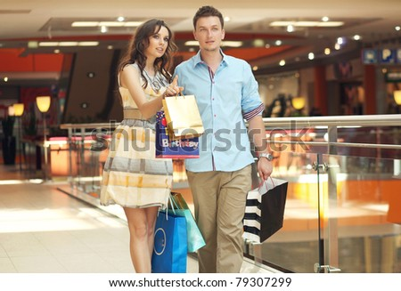 Smiling couple shopping - stock photo