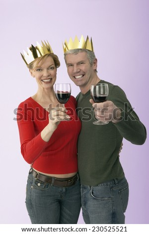 Smiling Couple Toasting with Red Wine - stock photo