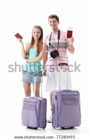 Smiling couple with passports and suitcases on a white background