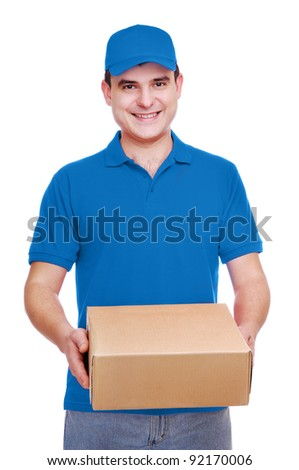 Smiling courier man in blue uniform holding the box on white background