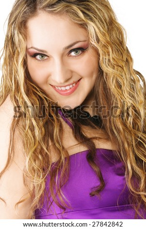 Smiling curly in violet dress closeup photo