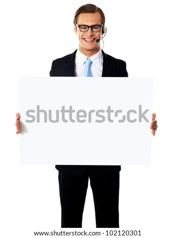 Smiling customer service male operator holding blank white billboard - stock photo