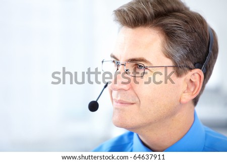 Smiling customer service operator in the office