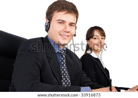 Smiling customer service representatives against a white background - stock photo