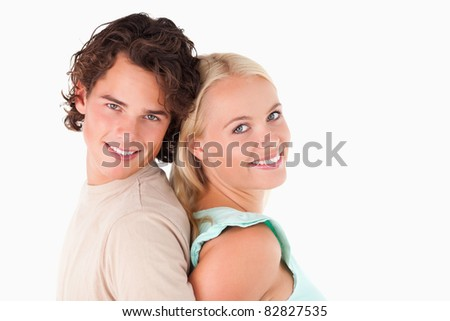 Smiling cute couple posing in a studio