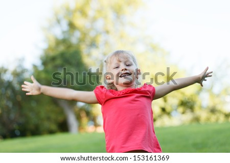 Smiling cute girl is happy - stock photo