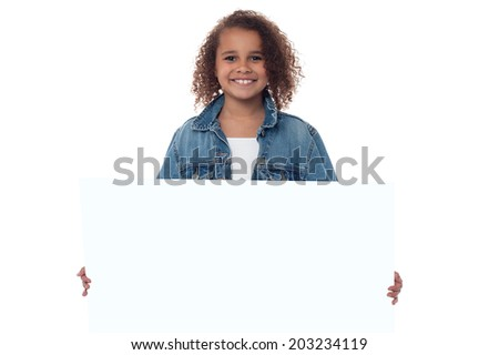 Smiling cute girl with blank white board - stock photo