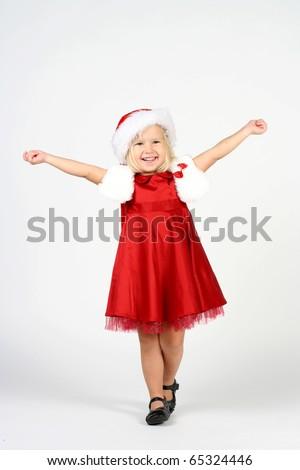 Smiling cute 3 years old girl in studio - stock photo