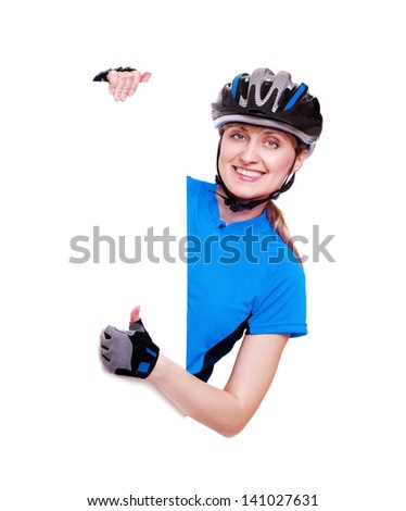 smiling cyclist girl in blue jersey showing thumbs up over the vertical blank board on white background - stock photo