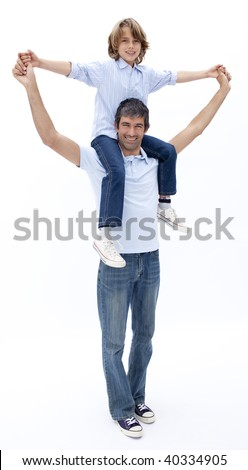 Smiling dad giving little boy piggy back ride against white background - stock photo
