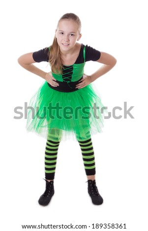 Smiling dancer in green tutu skirt standing isolated on white - stock photo