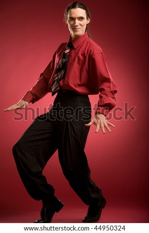 Smiling dancer on red background - stock photo
