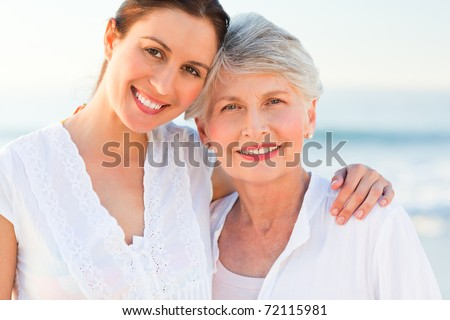 Smiling daughter with her mother - stock photo