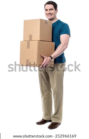 Smiling delivery man holding a big parcels