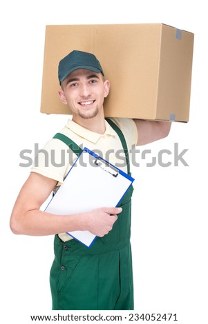 Smiling delivery man is holding a paper box isolated on white background. - stock photo
