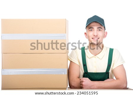 Smiling delivery man with cardboard boxes on white background. - stock photo