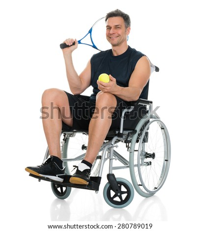 Smiling Disabled Man On Wheelchair Holding Racket And Ball