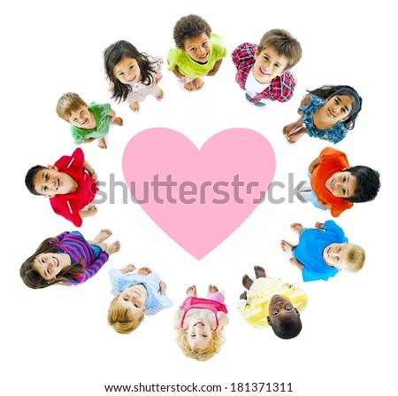 Smiling Diverse Children Around a Heart - stock photo