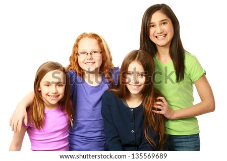 smiling diverse group of preteen girls hugging - stock photo
