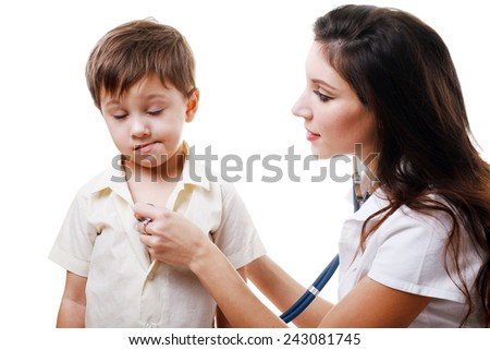 Smiling doctor auscultating a child with a stethoscope - stock photo