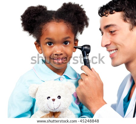 Smiling doctor examining his patient's ears against a white background - stock photo