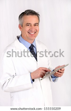 Smiling doctor holding a tablet - stock photo