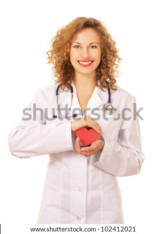 Smiling doctor holding heart, isolated on white background - stock photo