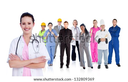 Smiling doctor in front of a team of different workers on white background - stock photo