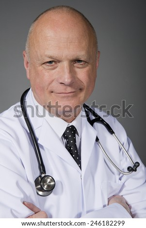 Smiling Doctor In White Lab Coat - stock photo