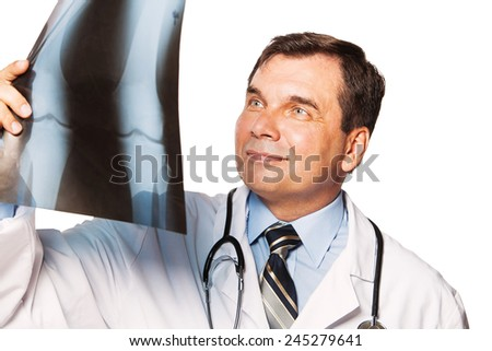 Smiling doctor whit radiography a over white background - stock photo
