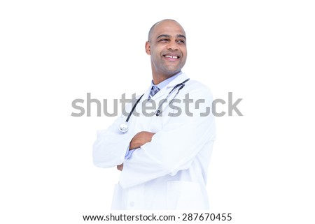 Smiling doctor with arms crossed looking away on white background