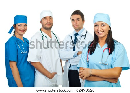 Smiling doctor woman with arms folded and her doctors team isolated on white background - stock photo