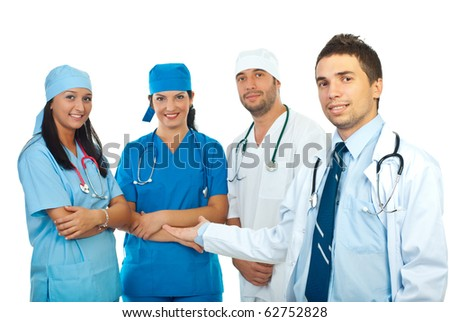 Smiling doctors presenting  his happy team of doctors isolated on white background - stock photo