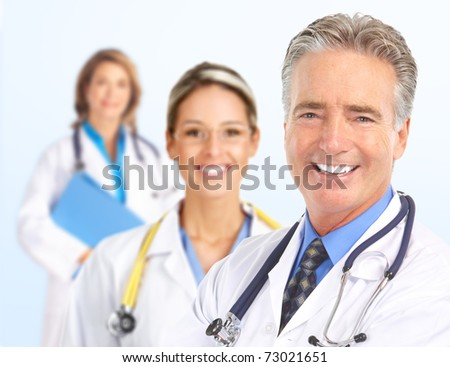 Smiling doctors with stethoscopes. Isolated over white background - stock photo